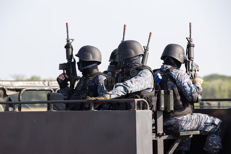Specialförband tjäna som soldat polisen, flugsmällagruppmedlem royaltyfri foto