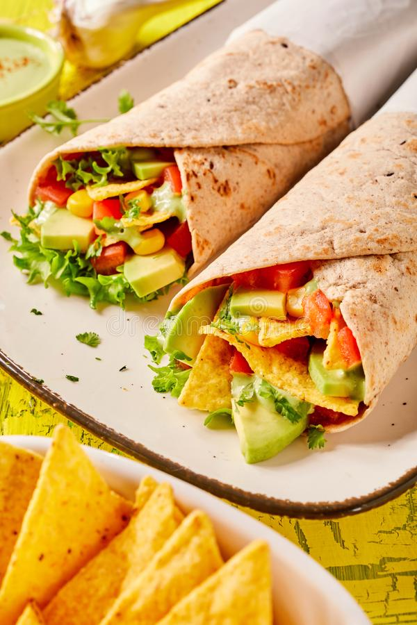 Speciality Mexican tortilla wraps with nachos royalty free stock photography