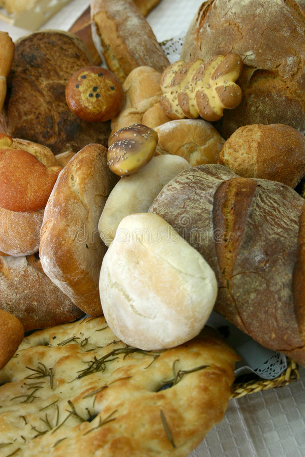 Specialty Bread. Assorted specialty breads sitting in a wicker basket. Taken from above, looking downward royalty free stock image