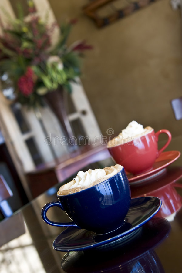 Specialty coffees. Mocha latte specialty coffees on table in restaurant stock photography