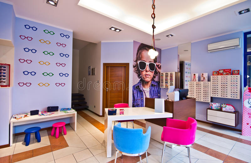 Specialty optician shop. Table and chairs in specialty optician shop for children in Koszalin, Poland stock image