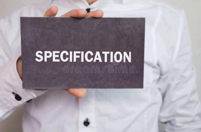 Specifikation för manvisningtext på en papp royaltyfri foto