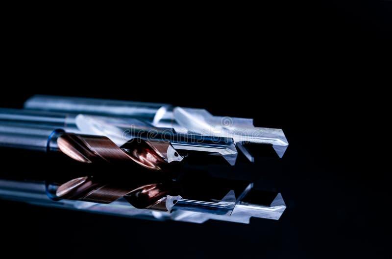 Specjalni narzędzia odizolowywający na czarnym tle Robić rozkazywać specjalnych narzędzia Pokryty kroka świder i rozszerzacza szc fotografia stock