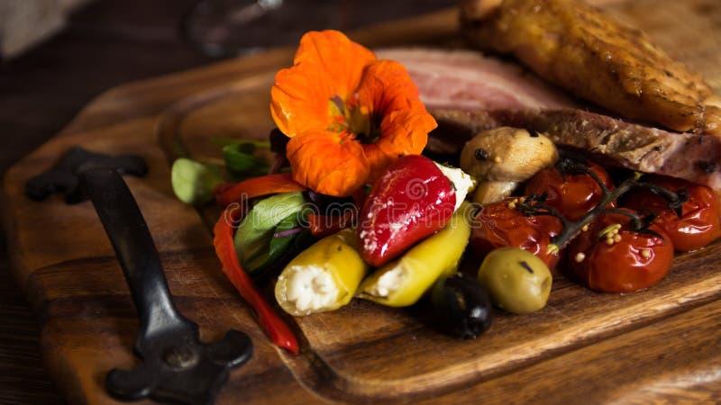 Speck mit Gemüse stockbild