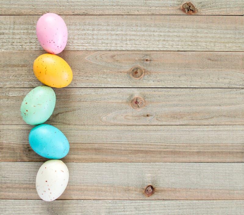 Speckled Easter egg border on a wooden background stock image
