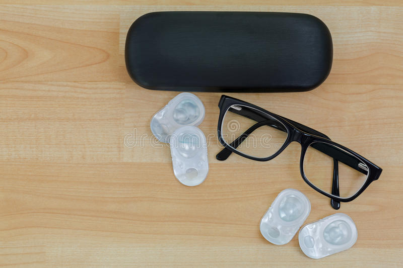 Spectacles with black frame, eye glasses case next to pairs of n royalty free stock images