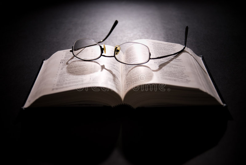 Spectacles and holy bible royalty free stock images