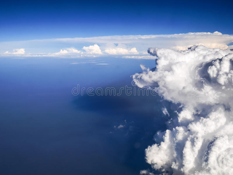 Spectacular aerial view from airplane window, beautiful, unique and picturesque white clouds with deep blue sky background. Amazing and unique cloudy sky with royalty free stock photo