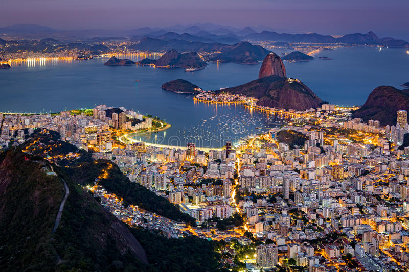 Spectacular aerial view over Rio de Janeiro. As viewed from Corcovado. The famous Sugar Loaf mountain sticks out of Guanabara Bay royalty free stock photo