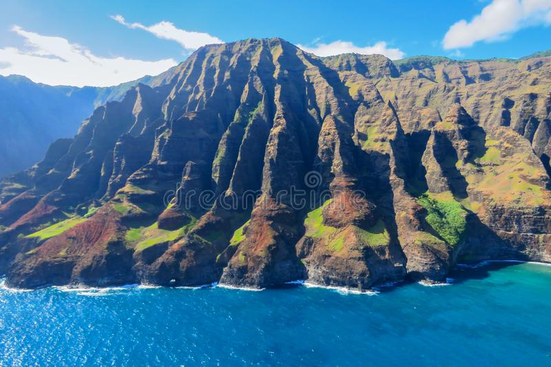 Aerial view of the Na Pali Coast shoreline, Kauai, Hawaii. Spectacular aerial view of the sea cliffs at the Na Pali Coast National Park, shot taken from a royalty free stock images