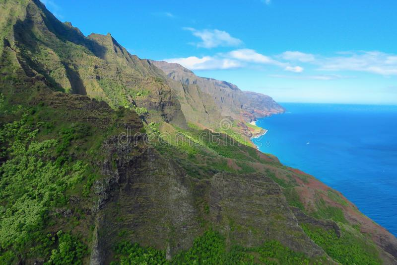 Panoramic landscape of Na Pali Coast National Park, Kauai, Hawaii. Spectacular aerial view of the sea cliffs at the Na Pali Coast, shot taken from a helicopter stock photo