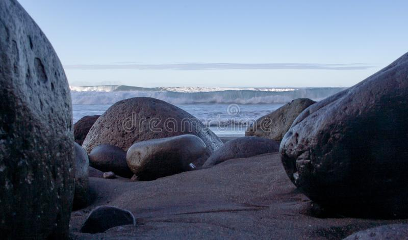 Spectacular beach view between rocks stock photos