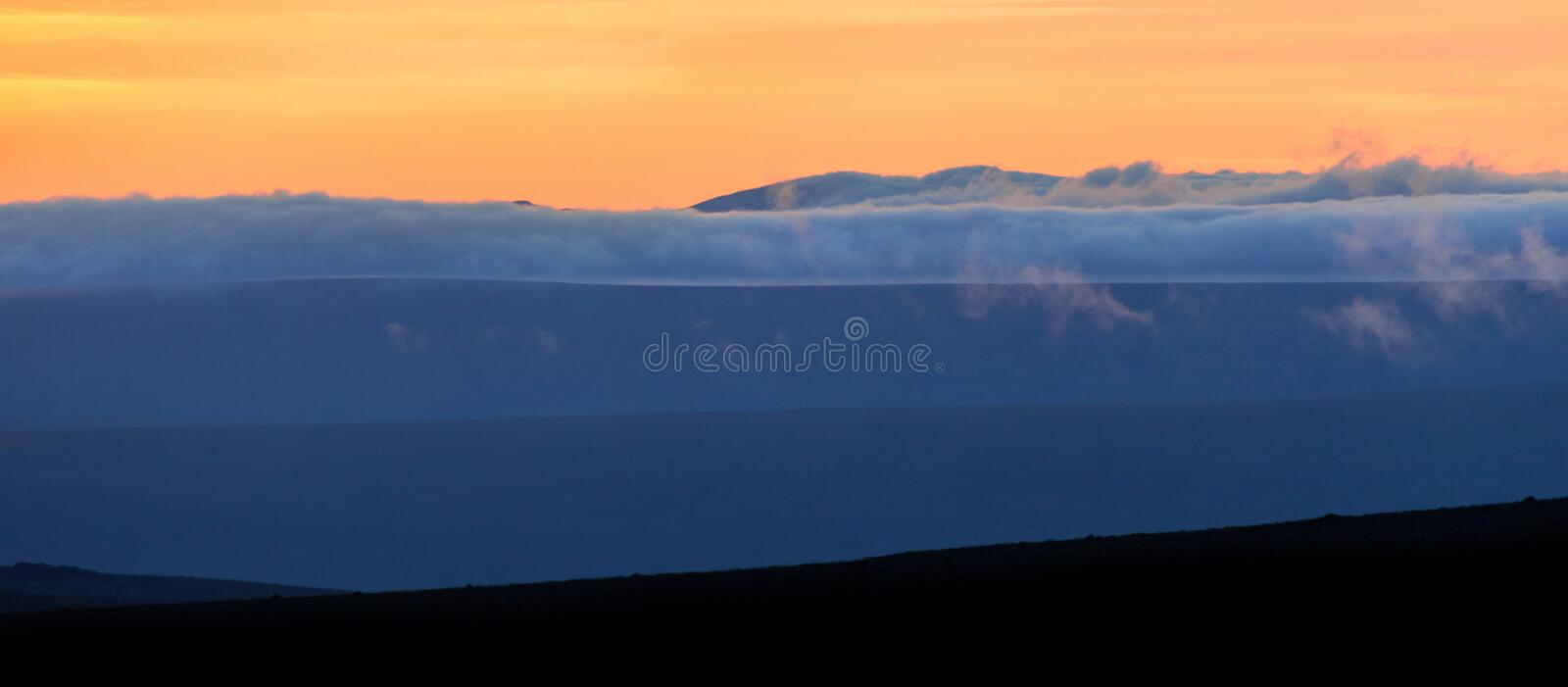 Spectacular blue layered mountain ranges silhouettes. Sunset landscape in Iceland. royalty free stock photo