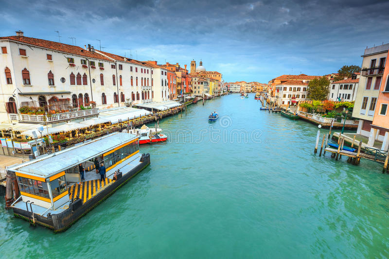 Spectacular canal with restaurant, hotels, boats in Venice, Italy, Europe royalty free stock photography