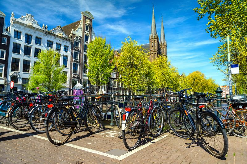 Spectacular cityscape with traditional Dutch buildings and bicycles, Amsterdam, Netherlands stock photography