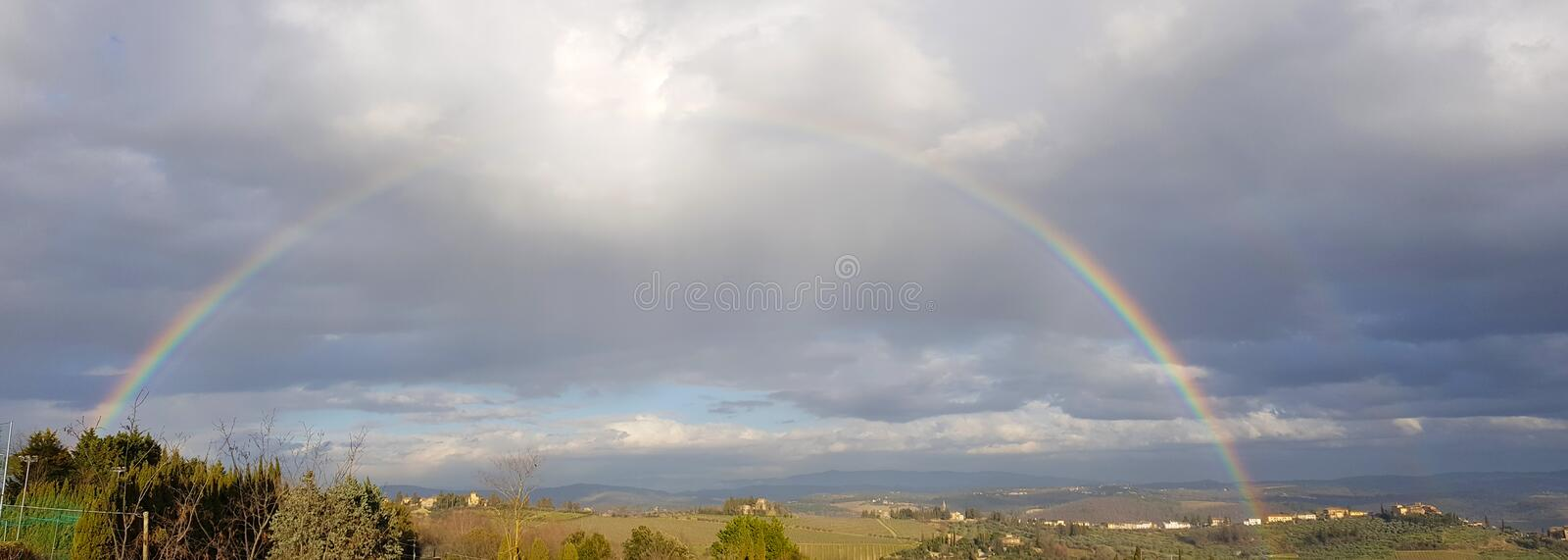 Spectacular complete rainbow over the Chianti hills, Tuscany, Italy royalty free stock image