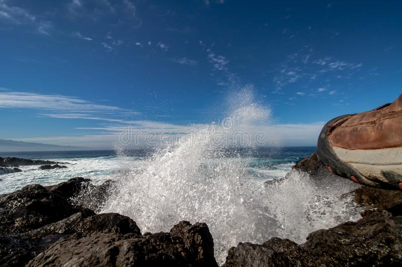 Spectacular crashing waves over the rocks royalty free stock photography