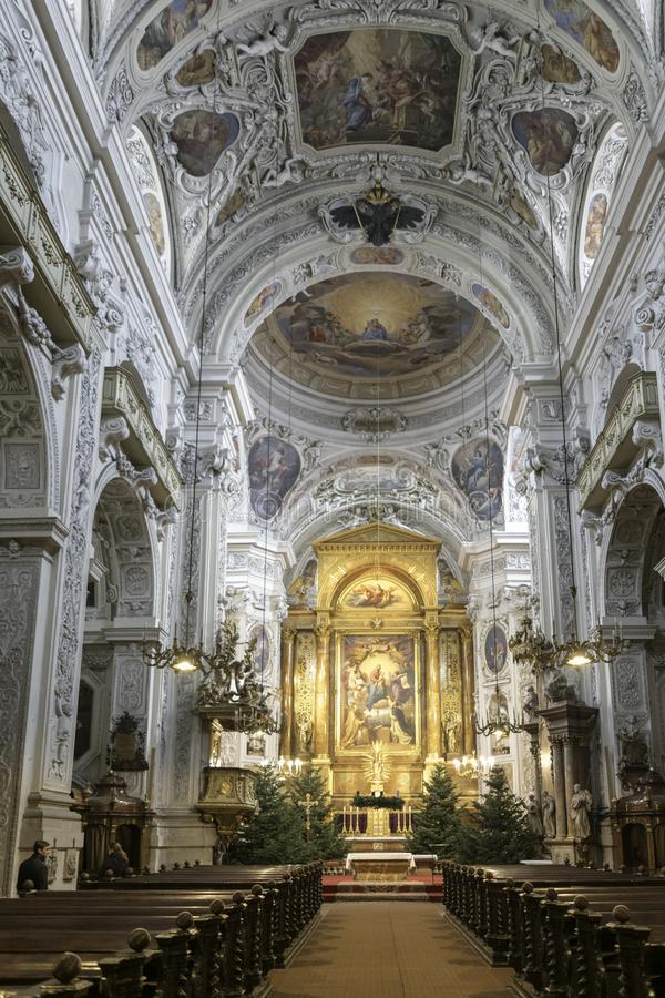 Inside Viennas spectacular churches, gold, ornate, designs and bling. Spectacular designs and artwork adorn Vienna churches and religious buildings, expensive royalty free stock photo