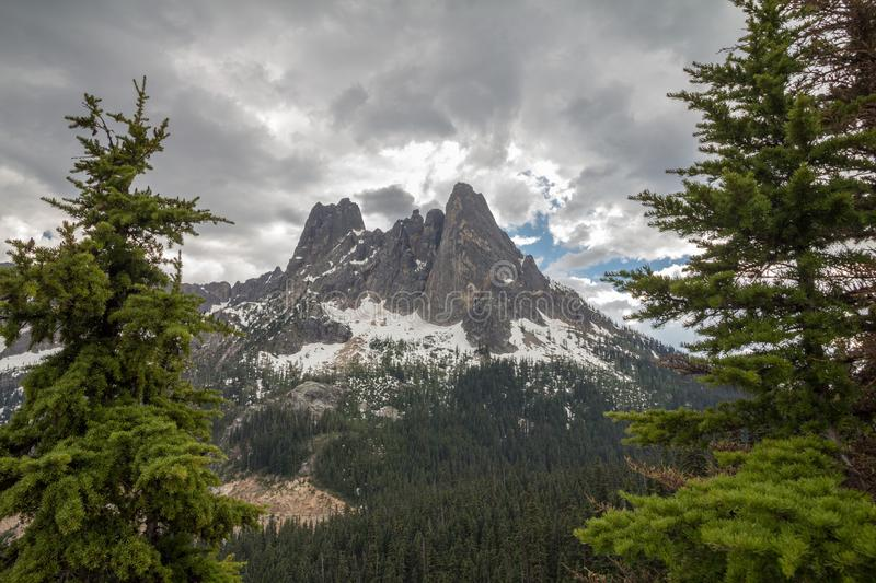 Spectacular early Winters Spires from Washington Pass Overlook,. The Early Winters Spires in Washington`s North Cascades - framed by conifer trees - in late royalty free stock photography