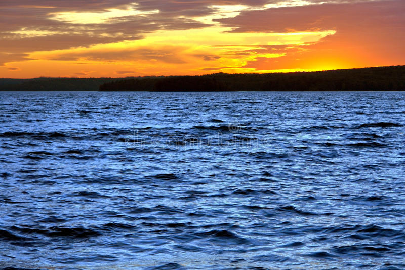 Spectacular Evening Sky Sunset Afterglow over Lake royalty free stock image