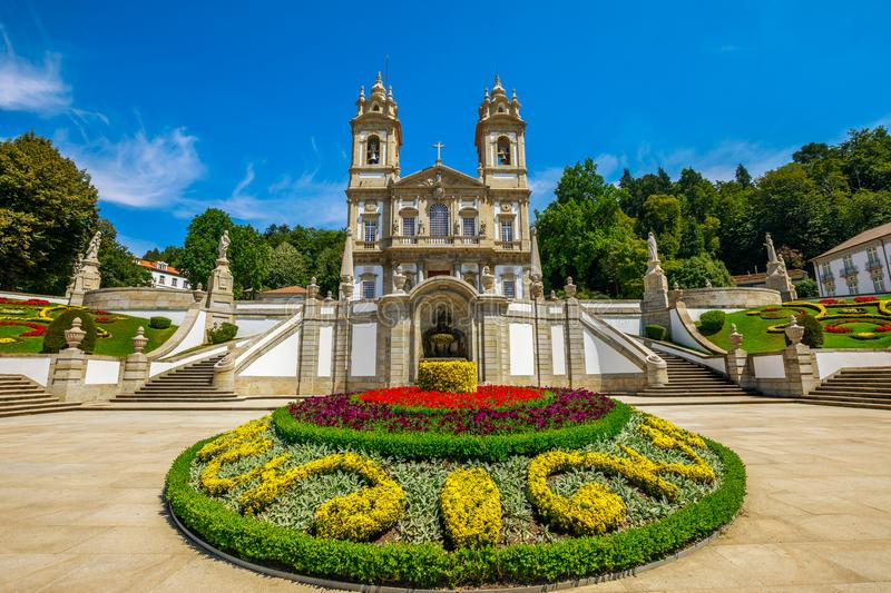 Braga Monastery Portugal. The spectacular facade of the Bom Jesus do Monte Sanctuary in neoclassical style surrounded by flowered gardens in a sunny day. Tenoes royalty free stock images