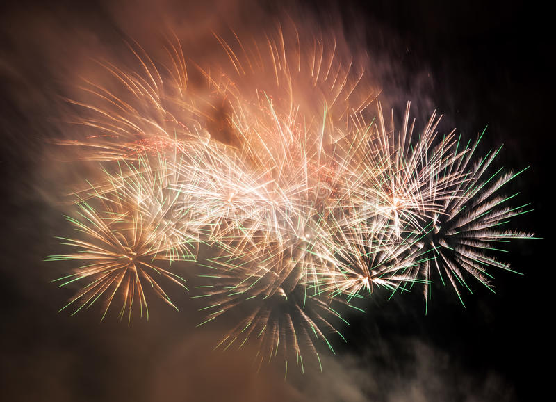 Spectacular fireworks show light up the sky. New year celebration. royalty free stock images