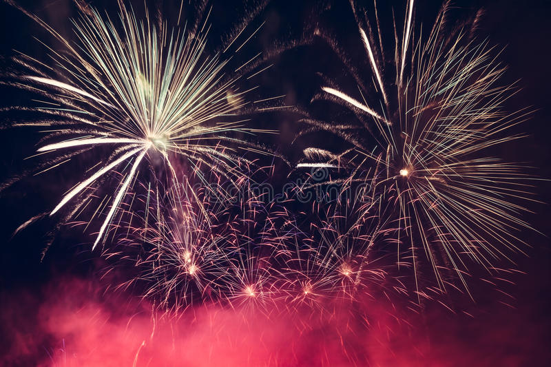 Spectacular fireworks show light up the sky. New year celebration. royalty free stock photography