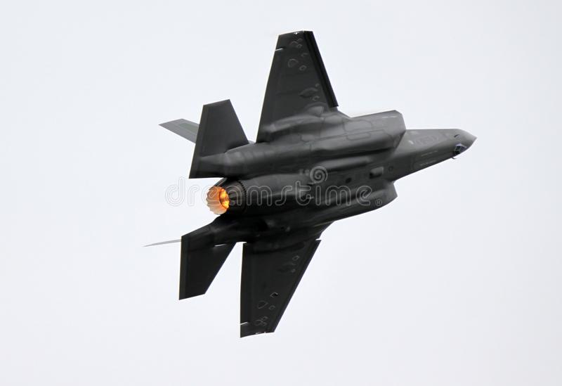Spectacular high G-turn by a F-35 Lighting II stock images