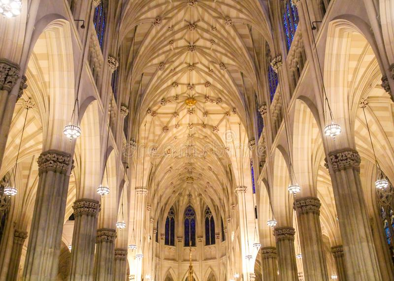 Spectacular inside view of Saint Patrick`s Cathedral interior, at St. Patrick`s day in Manhattan stock photo