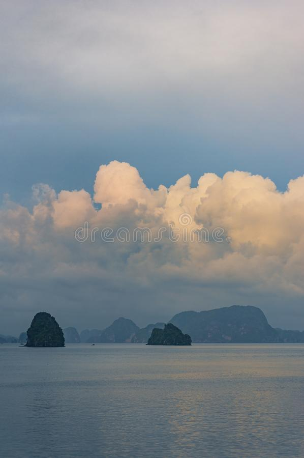 Spectacular landscape with colorful sunset clouds over HaLong Bay, Vietnam royalty free stock photography