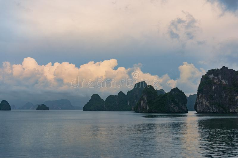 Spectacular landscape with colorful sunset clouds over HaLong Bay, Vietnam stock photo