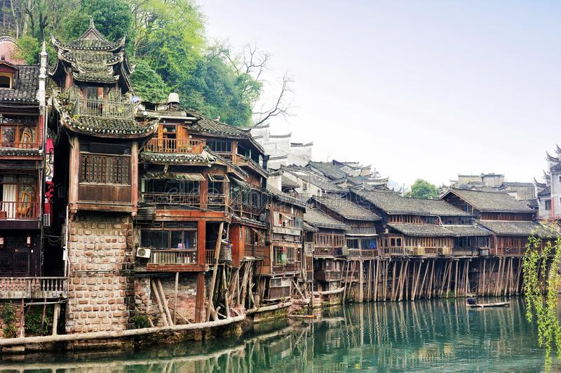 The Diaojiaolou traditional Chinese gabled wooden houses built on stilts be preserved in Fenghuang stock images