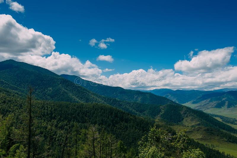 Spectacular landscape overlooking the green valley in the mountains. Journey in the mountains of Altai. Sunny summer day.  royalty free stock photos