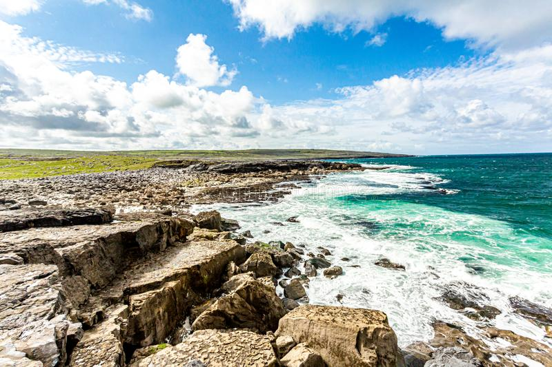 Spectacular landscape of the sea and limestone on the coast in Bothar nA hAillite. Geopark geosites, Wild Atlantic Way, beautiful spring day in County Clare in stock image