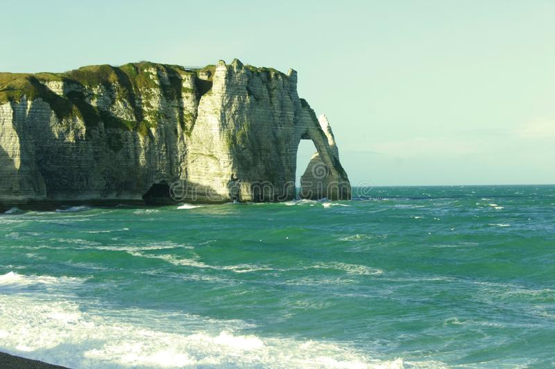 Spectacular natural cliffs Aval of Etretat and beautiful famous coastline, Normandy, France, Europe royalty free stock photography