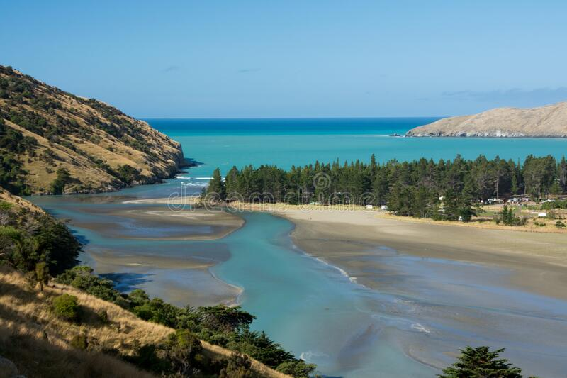 Spectacular Okains Bay. With turquoise water and patches of forest in Banks peninsula, New Zealand South Island royalty free stock photography