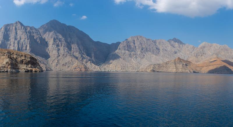 Spectacular panorama of the fjords and rocky mountains and blue waters of Khasab, Musandam, Oman in the Middle East near the royalty free stock photography