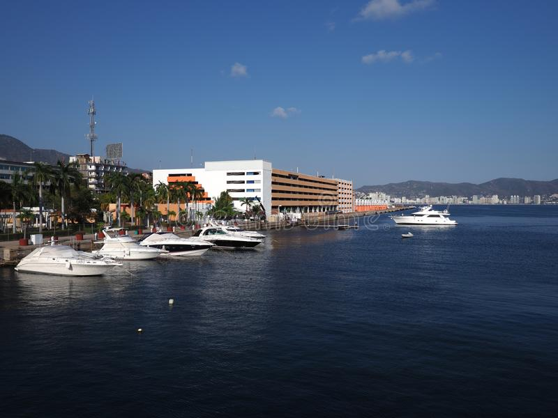 Spectacular panorama of luxury yachts at bay of mexican city of Acapulco in Mexico landscape royalty free stock photo