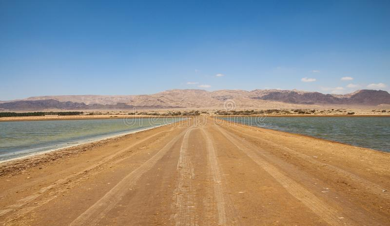 Unpaved road and the horizon stock image
