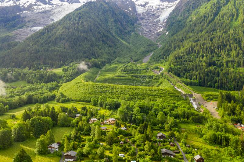 Spectacular scenery of green meadow and mountain in Chamonix valley. Beautiful scenery of green meadow and mountain in Chamonix valley stock image