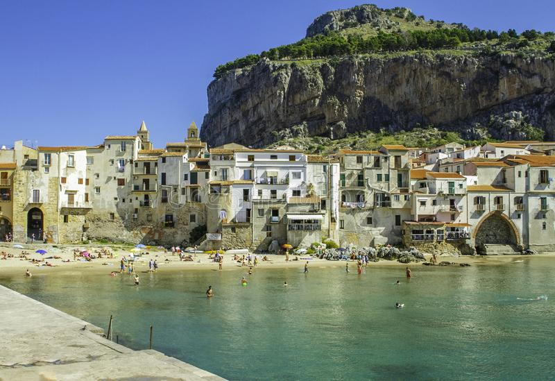 Spectacular scenic view of Cefalu` port, characteristic white houses, clear water and beach in Sicily stock images