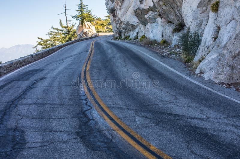 Spectacular serpentine of the rocky road on mountain Wilson, San Gabriel Mountains, California royalty free stock images