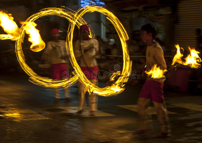 A spectacular site as Fire Ball Dancers perform along a street in Kandy during the Esala Perahera great procession in Sri Lanka. The Fire Ball Dancers play an stock photos