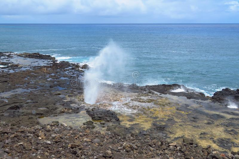 Spouting Horn blowhole, Poipu, Kauai, Hawaii. Spectacular Spouting Horn, a scenic blowhole on the South Shore of Kauai near Poipu, Hawaii royalty free stock images