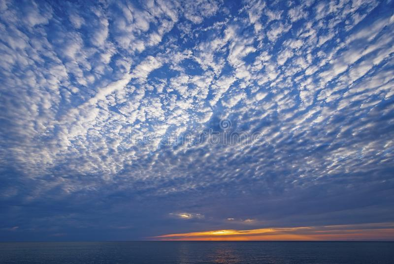 Spectacular Stratus Clouds Above the Sunset. On Lake Michigan near Montague, Michigan stock images