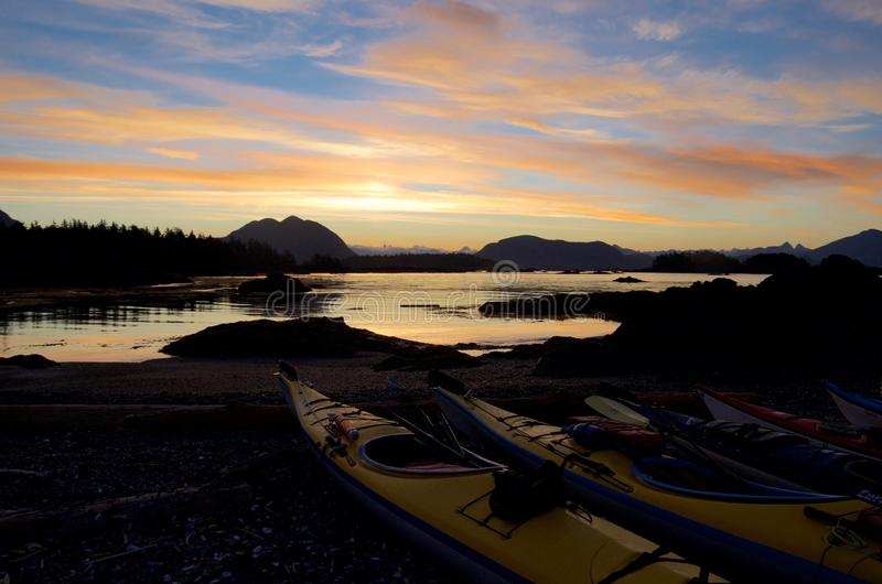 Spectacular sunrise seen from Spring Island with kayaks in the foreground stock images