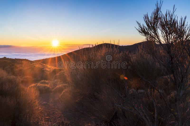 Spectacular sunset above the clouds in the Teide volcano national park stock image