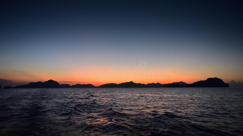 Spectacular sunset as viewed from Seven Commandos Beach at El Nido in Philippines. Spectacular sunset as viewed from Seven Commandos Beach at El Nido royalty free stock image