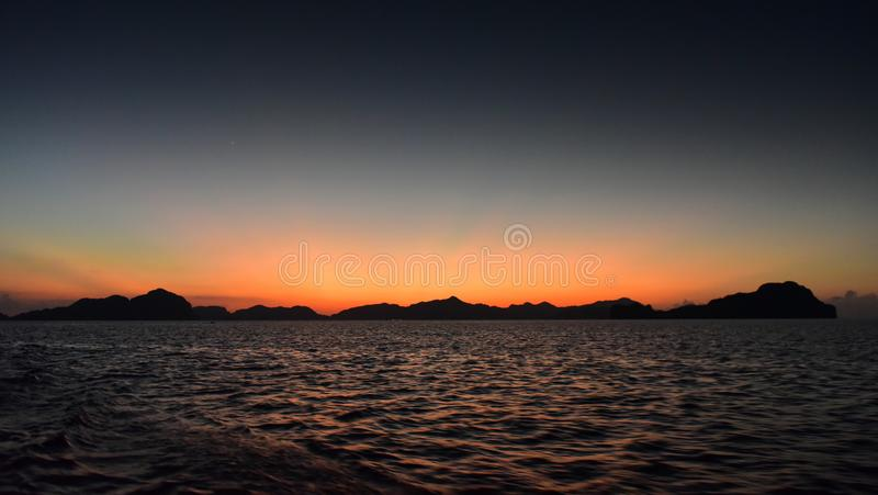 Spectacular sunset as viewed from Seven Commandos Beach in Philippines. Spectacular sunset as viewed from Seven Commandos Beach at El Nido, Philippines stock image