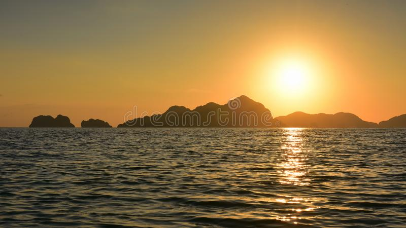Spectacular sunset as viewed from Seven Commandos Beach in Philippines. Spectacular sunset as viewed from Seven Commandos Beach at El Nido, Philippines royalty free stock photos